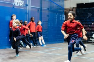 Rackets Cubed kids running on court
