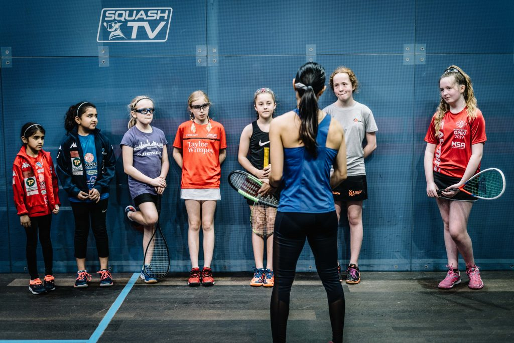 Juniors on court with Nicol David
